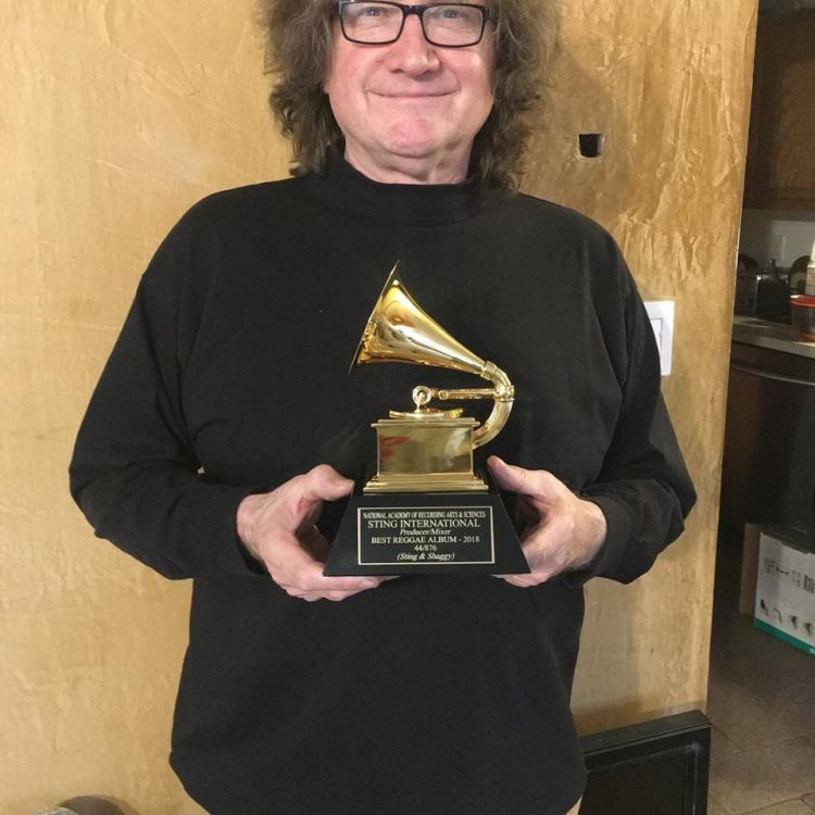 Andy Bassford from Island Head reggae musicians holding the grammy for the recording of the reggae album of the year Sting & Shaggy 44/876